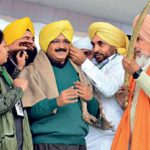 Arvind Kejriwal (centre) of the AAP tries out a turban-will he rule Punjab?