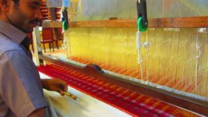 A weaver at work on a hand loom