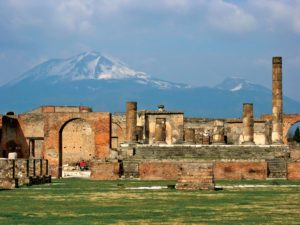 The ruins of Pompei with Mount Vesuvius seen in the background.
